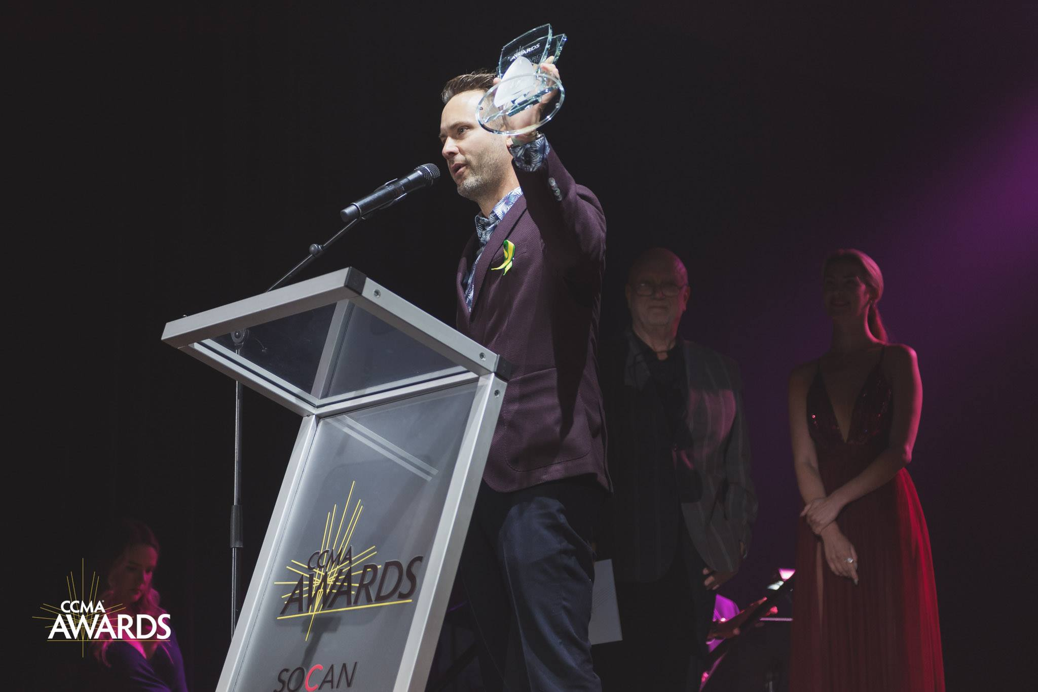 Dallas Smith accepting the Video of the Year Award with Stingray Music's Country Music programmer, Greg Torrington looking on.